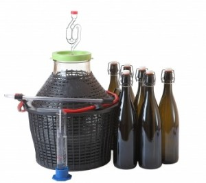 mead demijohn with bottles of mead and bottling cane
